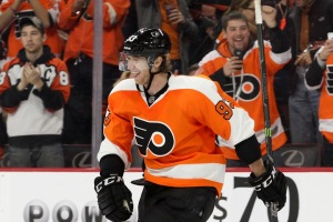 Right Wing Jakub Voracek (#93) of the Philadelphia Flyers sticks his tongue out after scoring an empty net goal to seal the victory