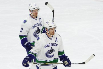 Center Henrik Sedin (#33 - left) and Left Wing Daniel Sedin (#22 - right) of the Vancouver Canucks