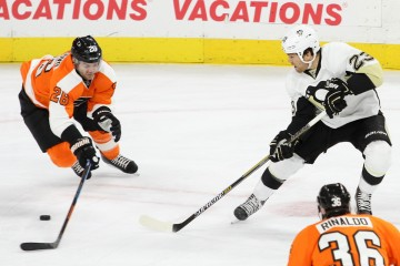 Defenseman Carlo Colaiacovo (#26) of the Philadelphia Flyers defends against a pass made by Right Wing Steve Downie (#23) of the Pittsburgh Penguins