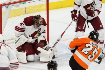 Goalie Mike Smith (#41) of the Arizona Coyotes stops a shot by Center Ryan White (#25) of the Philadelphia Flyers