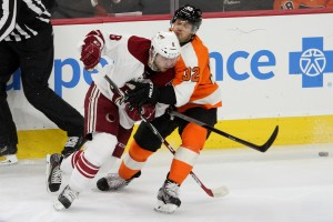 Defenseman Mark Streit (#32) of the Philadelphia Flyers defends against Right Wing Tobias Rieder (#8) of the Arizona Coyotes