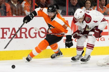 Right Wing Jakub Voracek (#93) of the Philadelphia Flyers fends off Defenseman Zbynek Michalek (#4) of the Arizona Coyotes