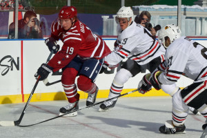 Nicklas Backstrom trailed by Jonathan Toews IMG_4204