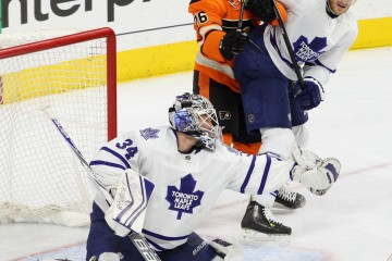Goalie James Reimer (#34) of the Toronto Maple Leafs makes a glove save