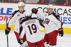 Center Alexander Wennberg (#41) and Center Ryan Johansen (#19) of the Columbus Blue Jackets congratulate teammate Defenseman James Wisniewski (#21) after he scored a goal