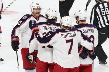 Members of the Columbus Blue Jackets congratulate each other after scoring against the Philadelphia Flyers