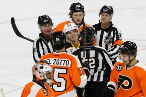 Center Tyler Ennis (#63) of the Buffalo Sabres exchanges words with Defenseman Michael Del Zotto (#15) of the Philadelphia Flyers
