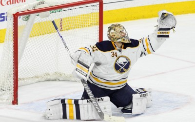 Goalie Michal Neuvirth (#34) of the Buffalo Sabres gloves the puck