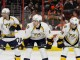 Center Craig Smith (#15), Center Filip Forsberg (#9), and Defenseman Roman Josi (#59) of the Nashville Predators line up for a face-off