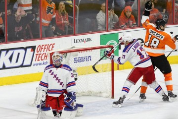 Left Wing R.J. Umberger (#18) of the Philadelphia Flyers celebrates a goal scored against Goalie Cam Talbot (#33) of the New York Rangers
