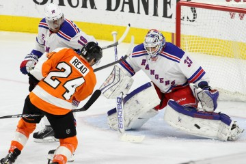 Goalie Cam Talbot (#33) of the New York Rangers makes a save against Right Wing Matt Read (#24) of the Philadelphia Flyers