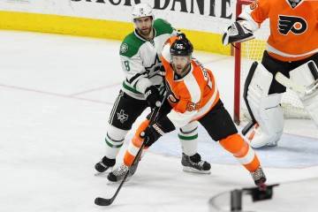 Right Wing Patrick Eaves (#18) of the Dallas Stars and Defenseman Nick Schultz (#55) of the Philadelphia Flyers battle for a spot at the top of the crease