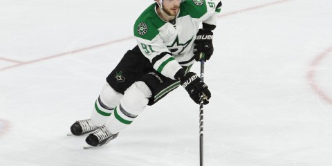 Center Tyler Seguin (#91) of the Dallas Stars turns while handling the puck