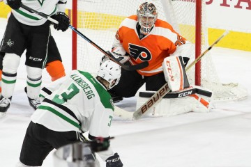 Goalie Steve Mason (#35) of the Philadelphia Flyers stares down Defenseman John Klingberg (#3) of the Dallas Stars