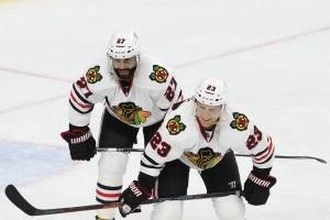 Defenseman Johnny Oduya (#27) and Left Wing Kris Versteeg (#23) of the Chicago Blackhawks line up for a face-off