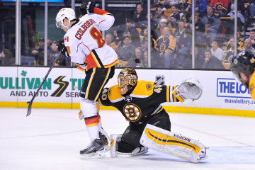 Calgary Flames center Joe Colborne deflects the puck in front of Boston Bruins goalie Tuukka Rask during an NHL game at the TD Garden. The Flames beat the Bruins 4-3 in a shootout. (Photo: Brian Fluharty)