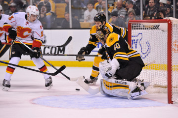 Calgary Flames left wing Johnny Gaudreau works the puck in front of Boston Bruins goalie Tuukka Rask during an NHL game at the TD Garden. The Flames beat the Bruins 4-3 in a shootout. (Photo: Brian Fluharty)
