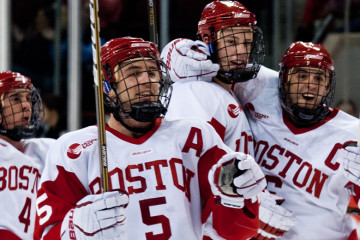 Boston's David Warsofsky, Adam Clendening, and Joe Pereira celebrating a goal during an exhibition game on October 2nd 2010. Boston University beat Toronto  9-3.