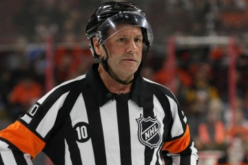 Referee Paul Devorski (#10) officiating his last NHL game