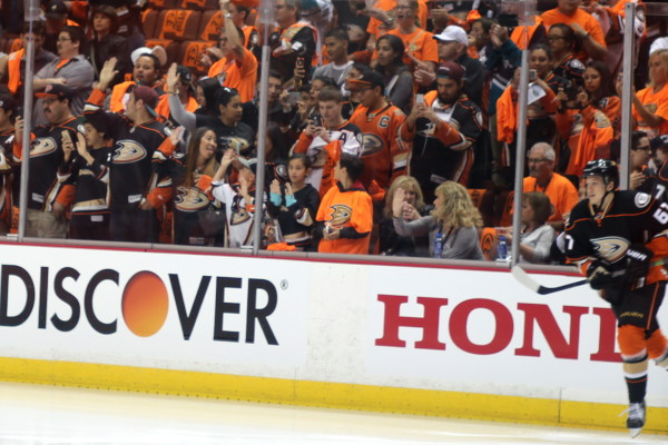 Center Rickard Rakell (#67) coming onto the ice in front of Ducks fans