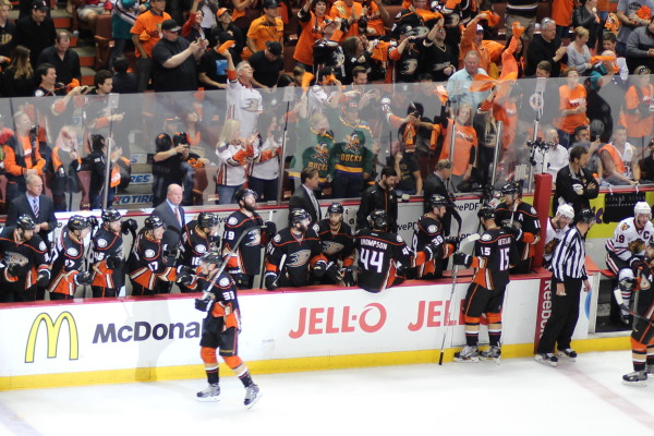 Tied for 2nd-leading scorer in playoffs with Patrick Kane, right winger Jakob Silfverberg (#33) celebrates his empty-net goal with the Ducks bench