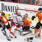 NHL 2015 - Sept 22 - NYR vs PHI - Members of the New York Rangers and Philadelphia Flyers battle in front of the net