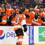 NHL 2015 - Sept 22 - NYR vs PHI - Defenseman Shayne Gostisbehere (#53) of the Philadelphia Flyers gets high-fives from the bench