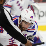 NHL 2015 - Sept 22 - NYR vs PHI - Center Jarret Stoll (#26) of the New York Rangers eyes the puck