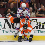 NHL 2015 - Sept 22 - NYR vs PHI - Right Wing Richard Nejezchleb (#85) of the New York Rangers shoves Center Tim Brent (#37) of the Philadelphia Flyers off-balance