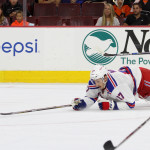 NHL 2015 - Sept 22 - NYR vs PHI - Center Luke Adam (#17) of the New York Rangers dives for the puck