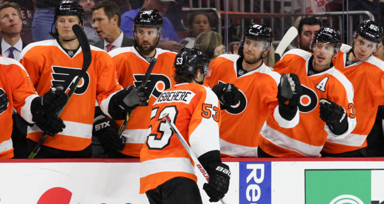 Defenseman Shayne Gostisbehere (#53) of the Philadelphia Flyers gets high-fives from the bench