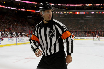 Referee Wes McCauley (#4) during the first period