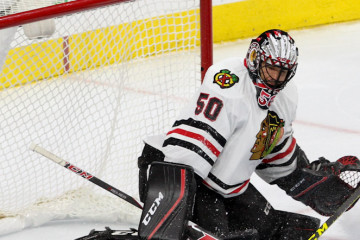 Defenseman Viktor Svedberg (#43) of the Chicago Blackhawks sticks away the puck during the second period