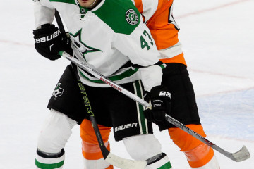 Right Wing Valeri Nichushkin (#43) of the Dallas Stars and Defenseman Evgeny Medvedev (#82) of the Philadelphia Flyers during the second period