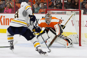 Goalie Steve Mason (#35) of the Philadelphia Flyers defends against Center Zemgus Girgensons (#28) of the Buffalo Sabres during the third period
