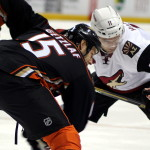 Faceoff between Ryan Getzlaf (#15) and Martin Hanzal (#11)