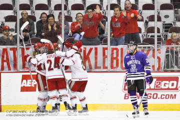 The Ohio State Knucklebucks celebrate the second goal scored by Claudia Kepler (OSU - 24).