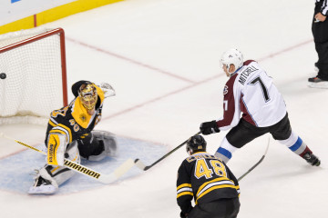Colorado Avalanche center John Mitchell (7) scores on Boston Bruins goalie Tuukka Rask (40).