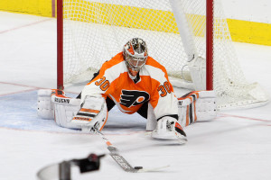 Goalie Michal Neuvirth (#30) of the Philadelphia Flyers uses his stick to control the rebound during the second period
