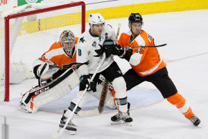 Defenseman Michael Del Zotto (#15) of the Philadelphia Flyers shoves Center Joe Pavelski (#8) of the San Jose Sharks during the third period