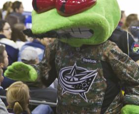 Blue Jackets mascot Stinger celebrates both Military Appreciation Night and Movember.
