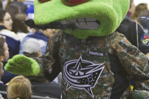 Blue Jackets mascot Stinger celebrates both Military Appreciation Night and Movember.