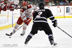 Josh Melnick (MIA - 37) skates the puck into the UNO zone.
