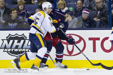 Craig Smith (NSH - 15) knocks Jack Johnson (CBJ - 7) off the puck.