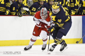 Mason Jobst (OSU - 26) battles Dexter Dancs (UM - 39) for the puck.