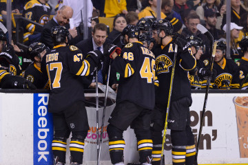 The Bruins gather during a timeout during a NHL game in Boston's TD Garden.