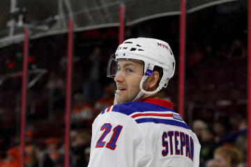 Center Derek Stepan (#21) of the New York Rangers during the warm-ups