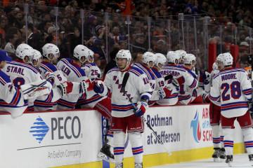 Center J.T. Miller (#10) of the New York Rangers gets high-fives from his teammates during the first period