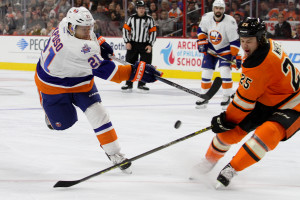 Right Wing Ryan White (#25) of the Philadelphia Flyers blocks a shot from Right Wing Kyle Okposo (#21) of the New York Islanders during the second period