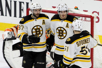 Center Patrice Bergeron (#37), Right Wing Loui Eriksson (#21) and Center Ryan Spooner (#51) of the Boston Bruins celebrate a goal scored in the second period